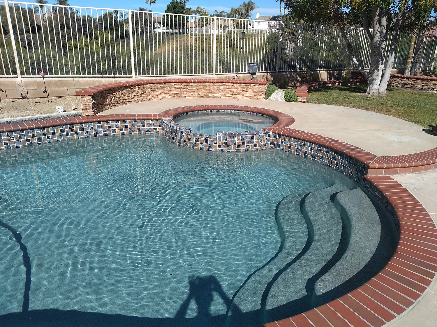 Pool restoration re-tile and repair